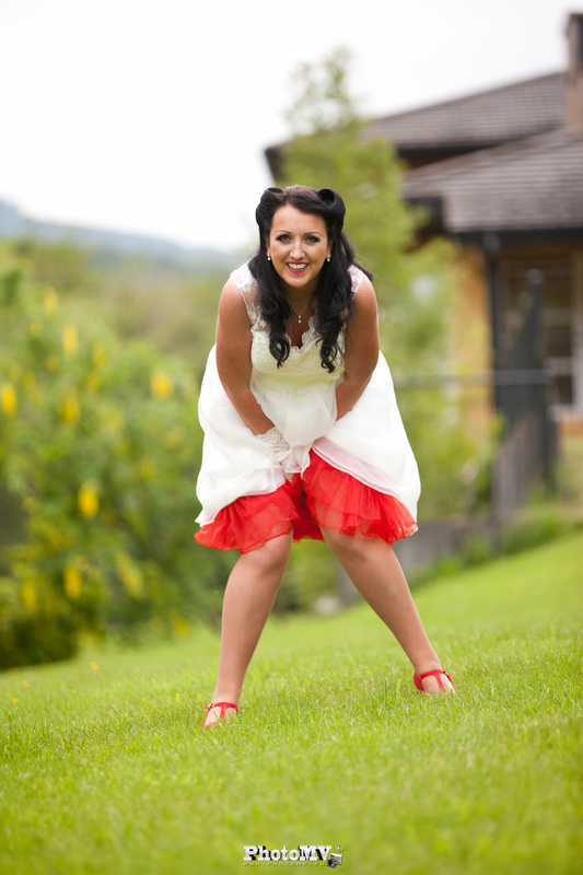 Bride in a red and white dress having fun