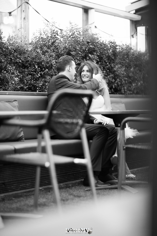 bride and groom sitting in restaurants balcony in Dublin