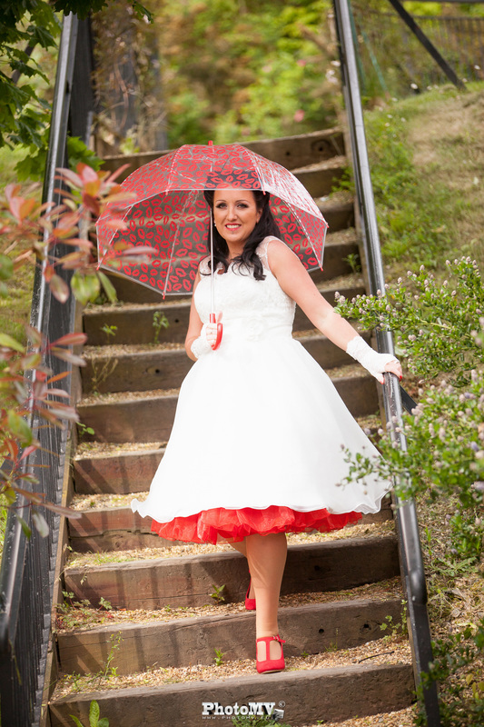 Bride stepping on a stairs in umbrella