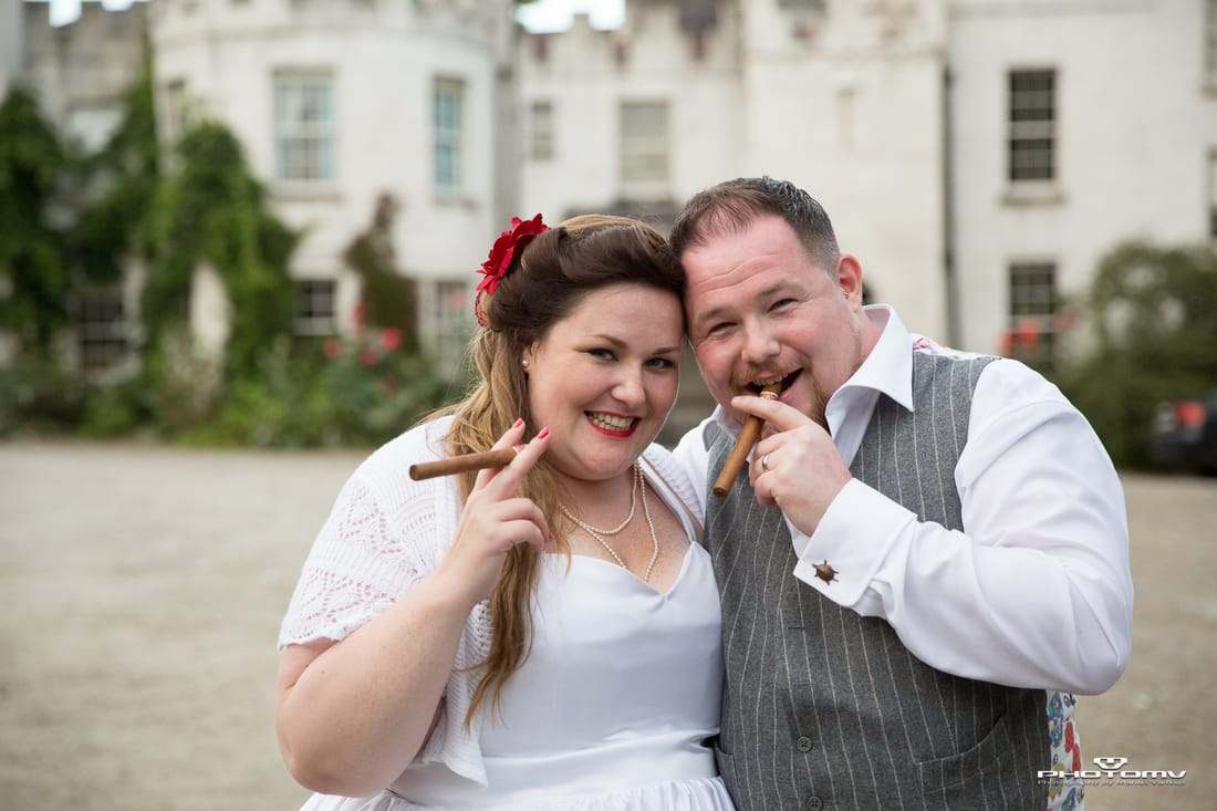 Bride and groom having a cigar