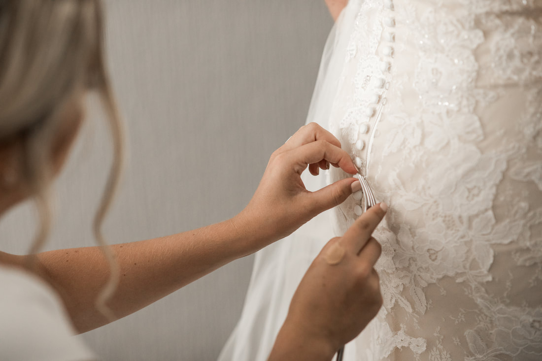 fork and brides dress, how to button wedding dress in easy way