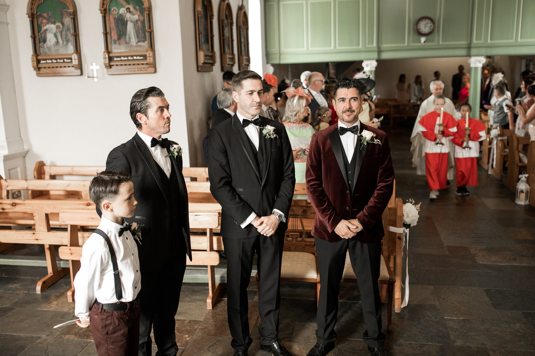 groom and groomsmen at a church in Carlingford