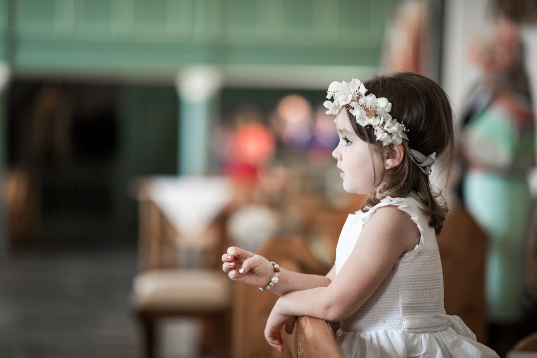 Flower girl dreaming at a wedding