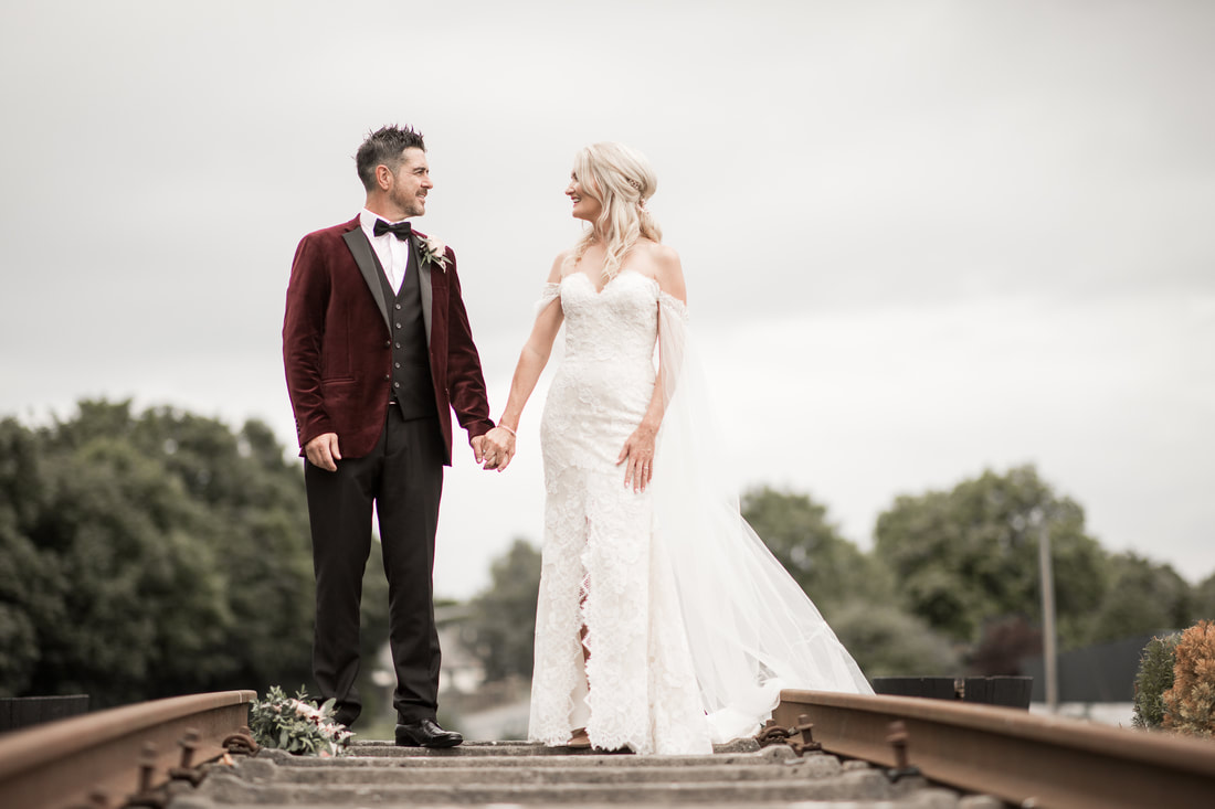 Bride and groom on a railway in Carlingford
