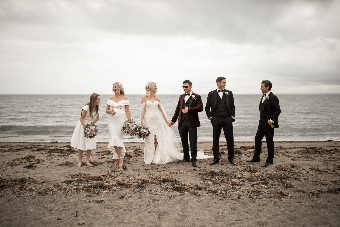 Bridal party at a beach in Dundalk