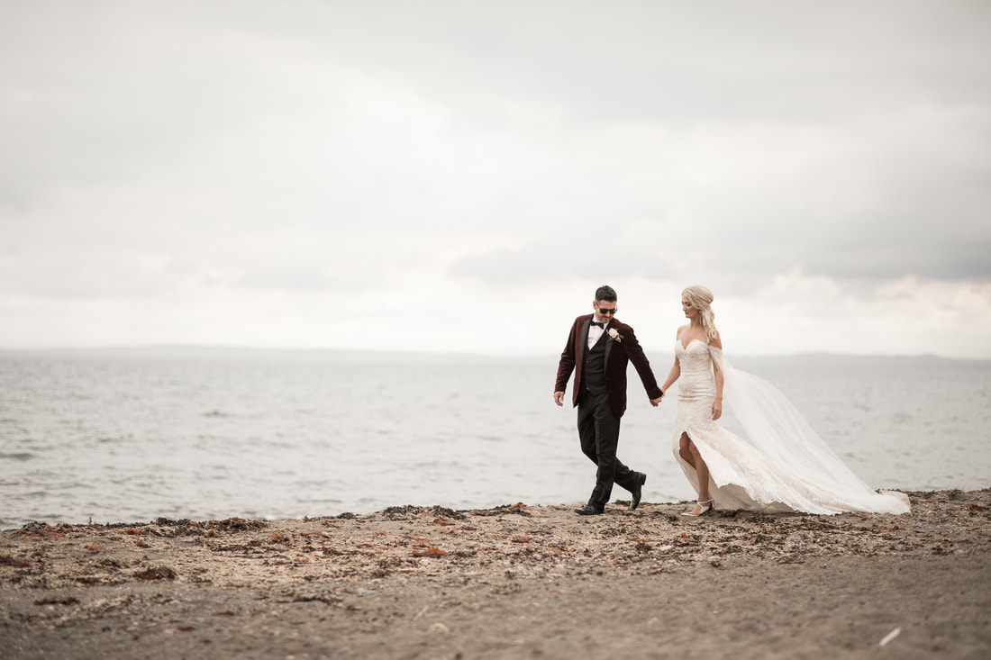 Lovely newlywed couple on a beach