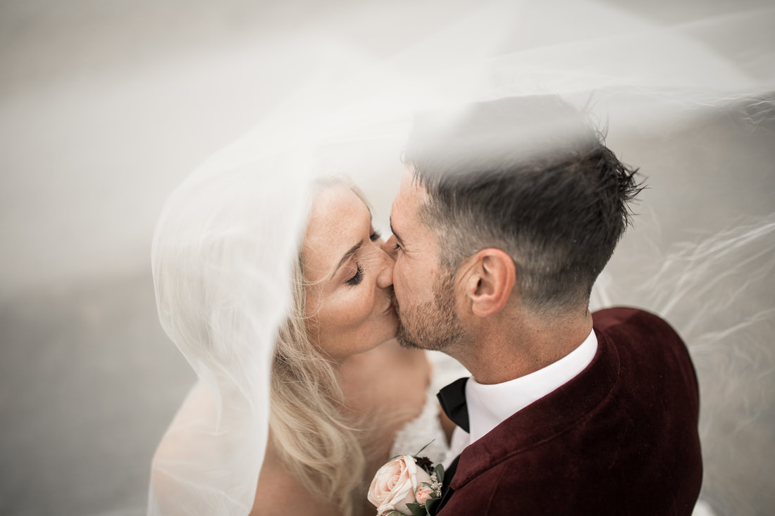 Bride and groom kissing. Award winning wedding videographer and photographer in Ireland