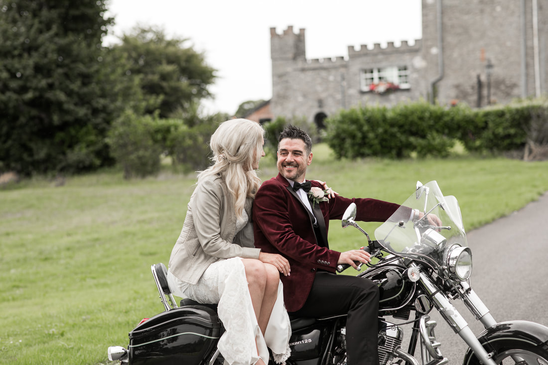 Groom with a bride on a chopper at Darver Castle