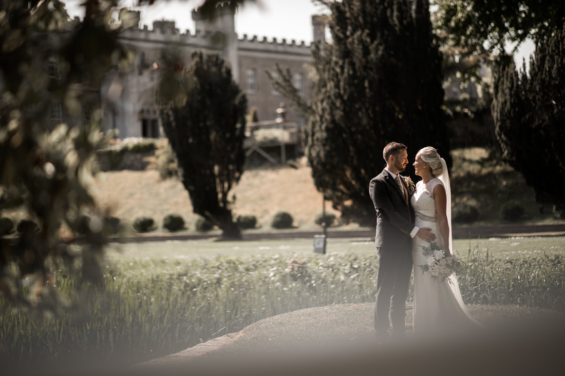 bride and groom in a sunlight at a castle
