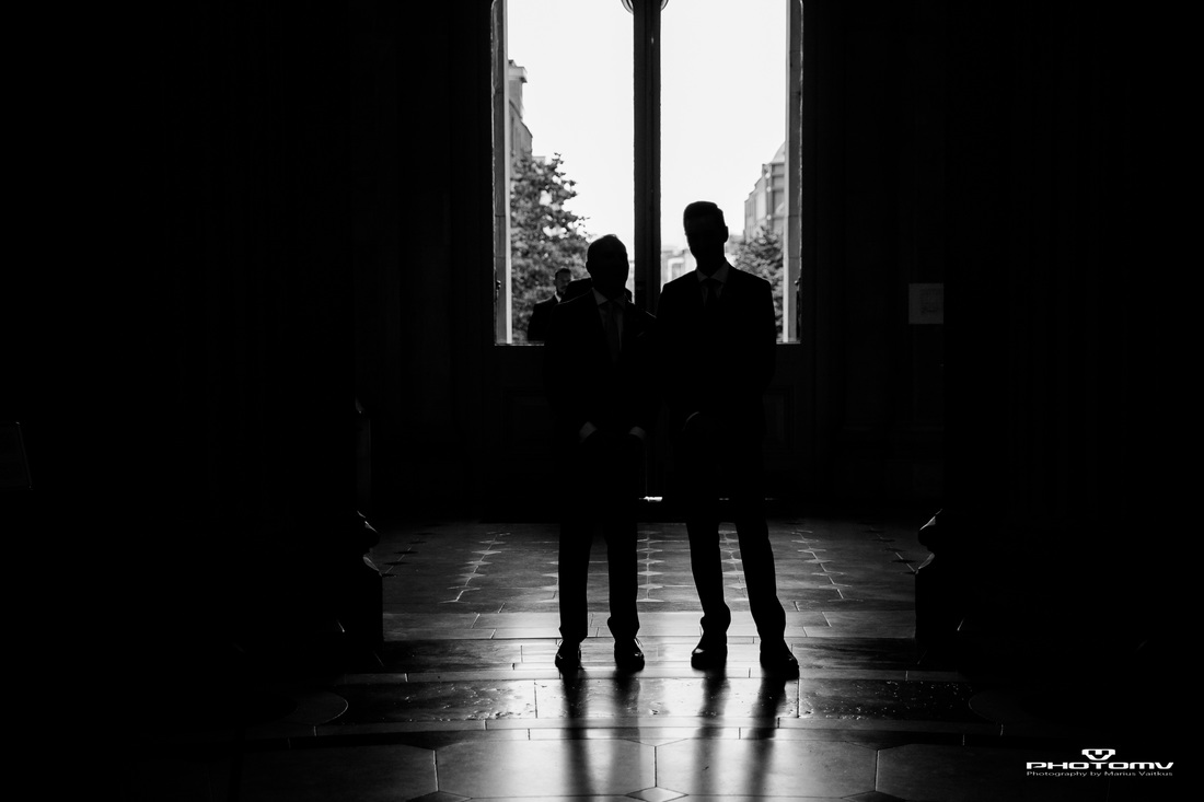 Silhouette of gay couple at their wedding