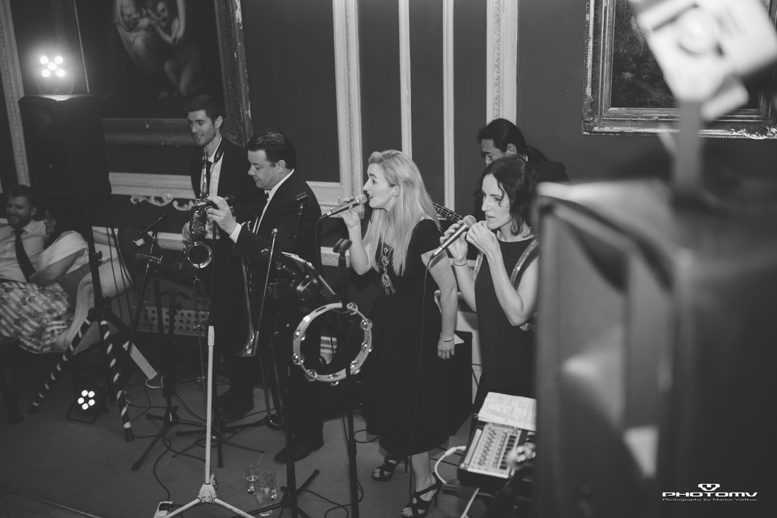 Band live playing at a wedding Dublin. Photography by PhotoMV