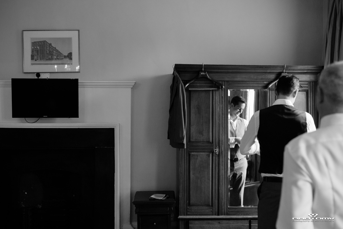 Sensual gay wedding morning preparation photo in B&W