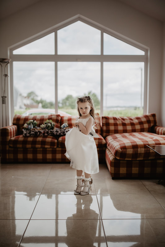 Little girl in a brides shoes