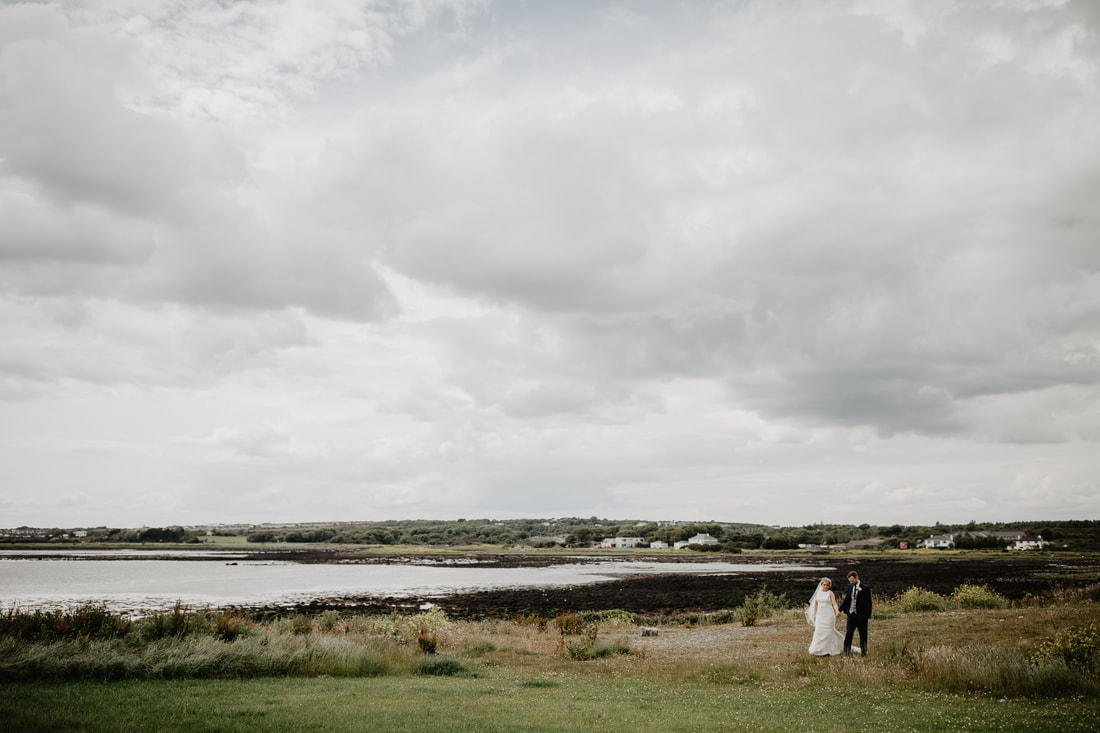 Bride and groom at a beach in Galway City