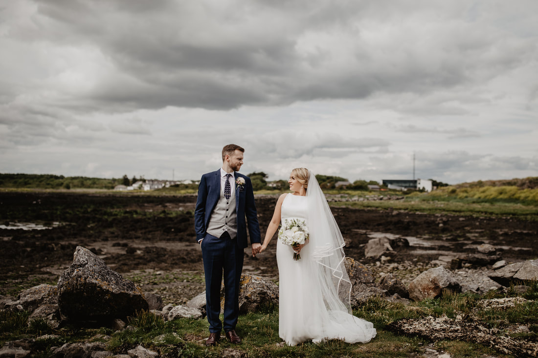 Bride and groom on a shore in Galway