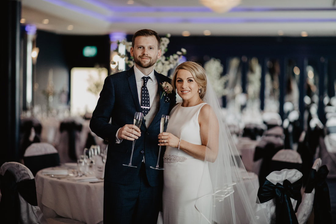 Bride and groom in a function room at the G Hotel and Spa, Galway