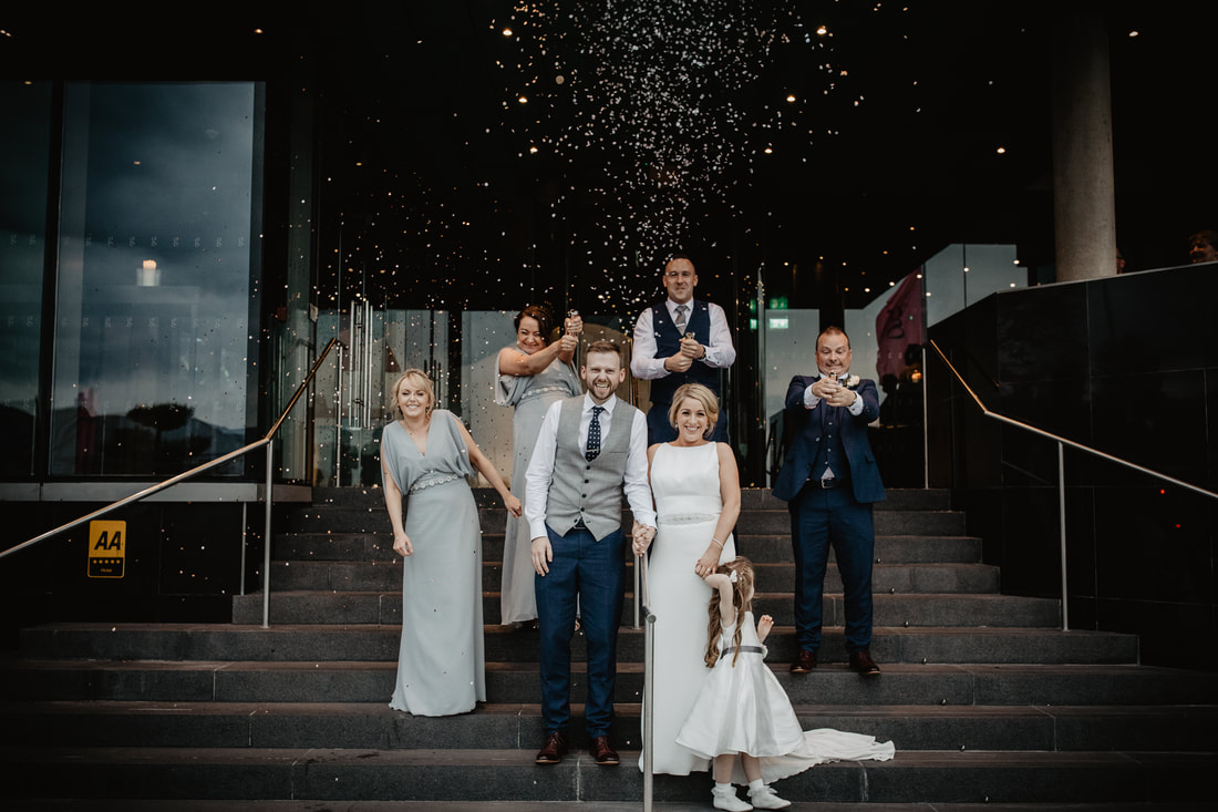 Wedding Confetti, bride and groom , bridal party. Front entrance to The G Hotel, Galway