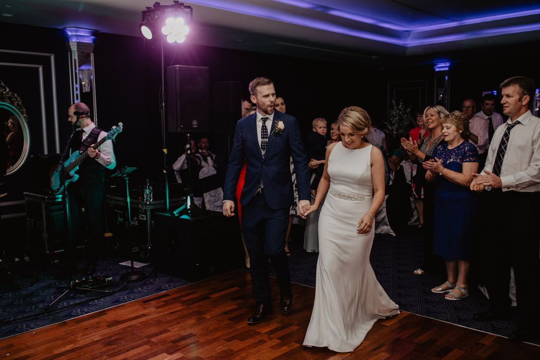 Bride and groom entering for first dance at The G Hotel, Galway