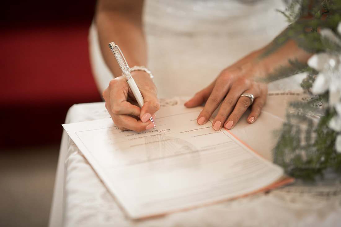 bride signs the documents at a wedding in Ireland