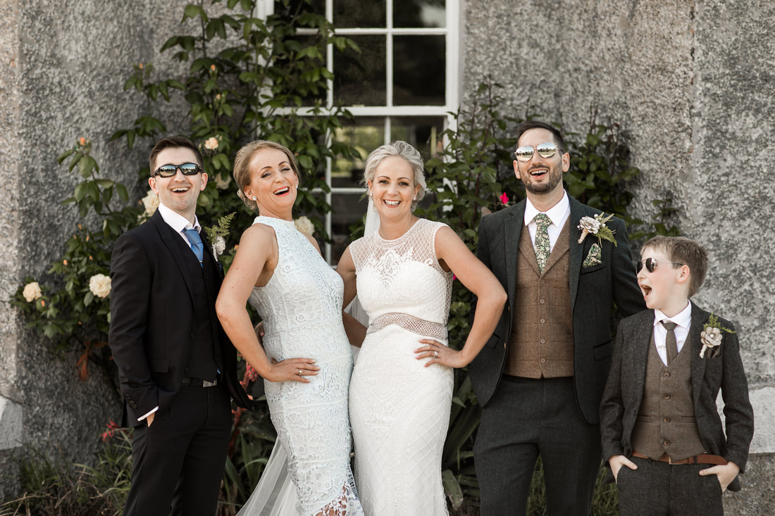 Fun and relaxed Wedding group shot at Bellingham castle