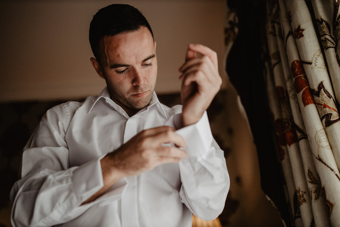 Groom is getting ready, at Clanard Court Hotel, Athy, Co. Kildare by wedding photographer Mario Vaitkus