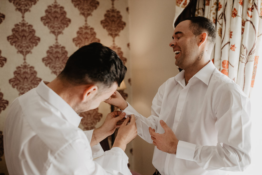groom and best man getting ready for a wedding, at Clanard Court Hotel, Athy, Co. Kildare by wedding photographer Mario Vaitkus