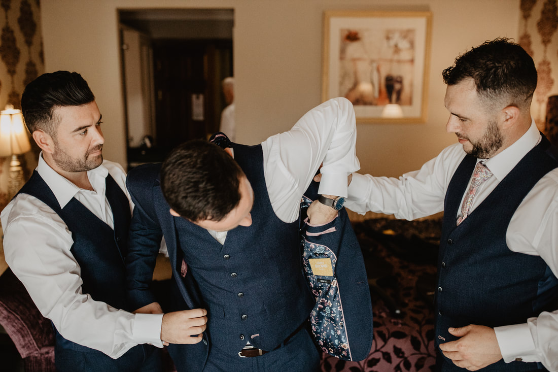 Getting ready, groomsmen at Clanard Court Hotel, Athy, Co. Kildare by wedding photographer Mario Vaitkus