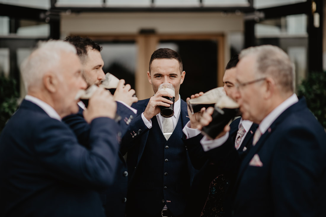 Groom and Guinness at Clanard Court Hotel, Athy, Co. Kildare by wedding photographer Mario Vaitkus