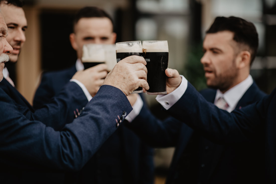 Groomsmen and Guinness, cheers at Clanard Court Hotel, Athy, Co. Kildare by wedding photographer Mario Vaitkus