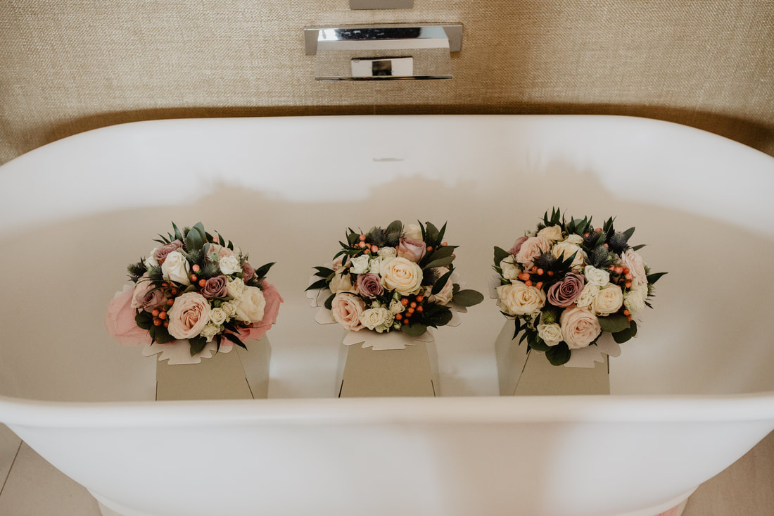 Flowers in a bath, at Clanard Court Hotel, Athy, Co. Kildare by wedding photographer Mario Vaitkus