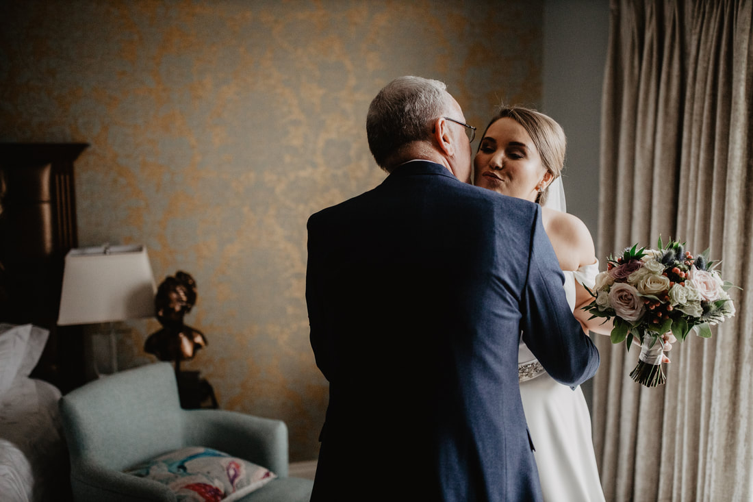 Bride and Father hug, at Clanard Court Hotel, Athy, Co. Kildare by wedding photographer Mario Vaitkus