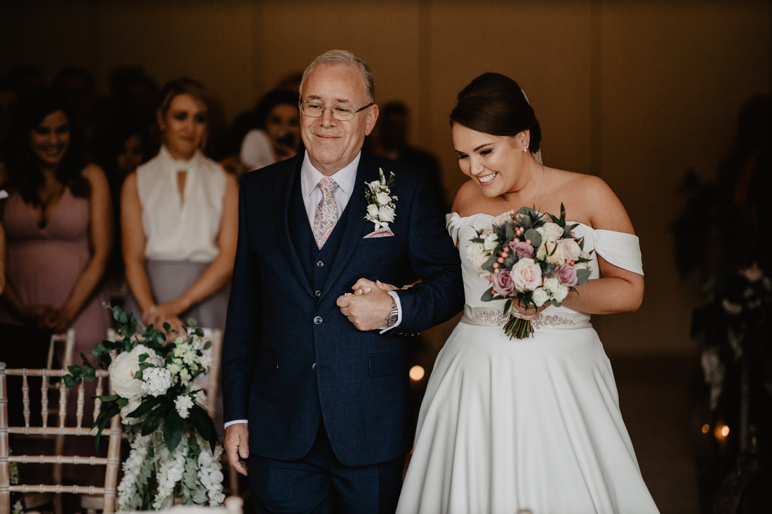 Bride and father down the aisle at Clanard Court Hotel, Athy, Co. Kildare by wedding photographer Mario Vaitkus