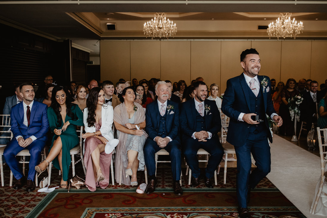 Wedding ceremony, best man brings the rings at Clanard Court Hotel, Athy, Co. Kildare by wedding photographer Mario Vaitkus