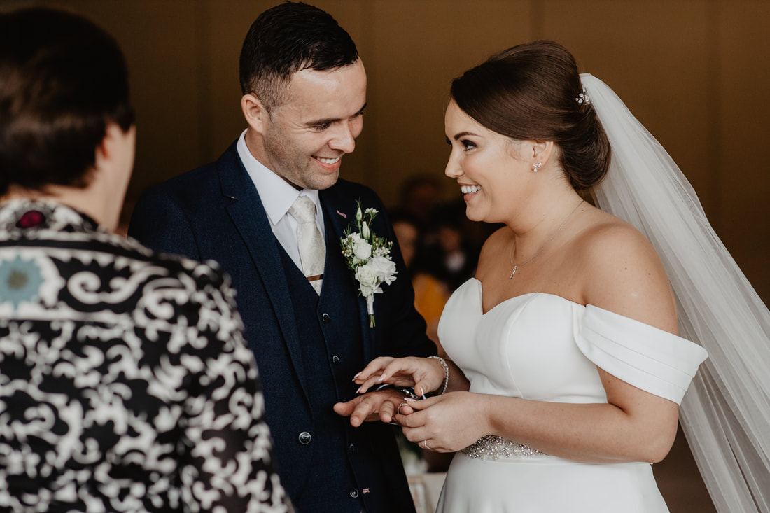 Bride puts the wedding ring on at Clanard Court Hotel, Athy, Co. Kildare by wedding photographer Mario Photo - Video Production