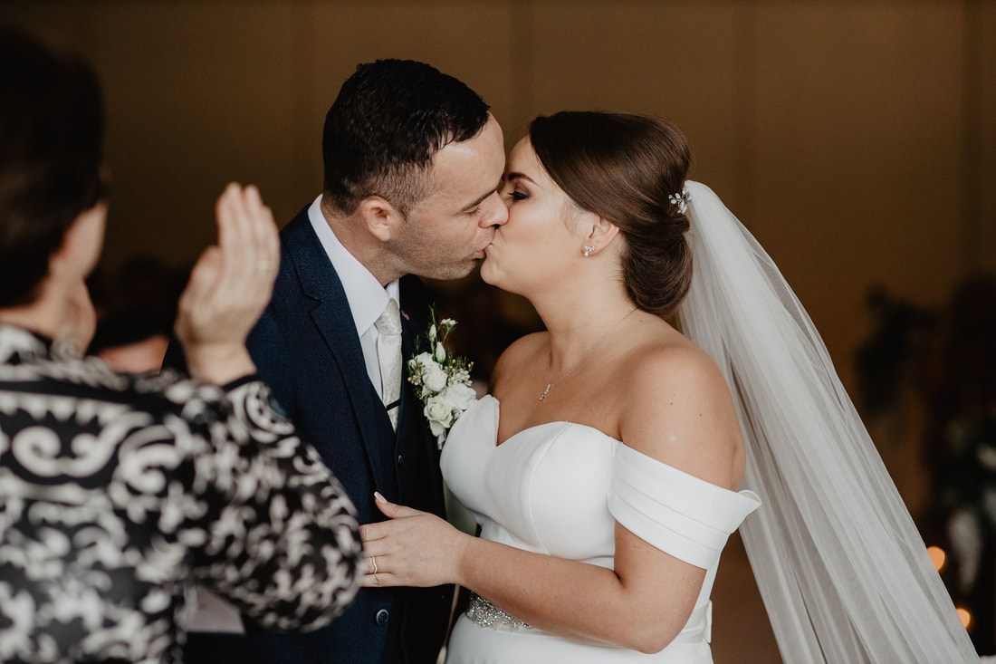 First kiss, at Clanard Court Hotel, Athy, Co. Kildare by wedding photographer Mario Vaitkus