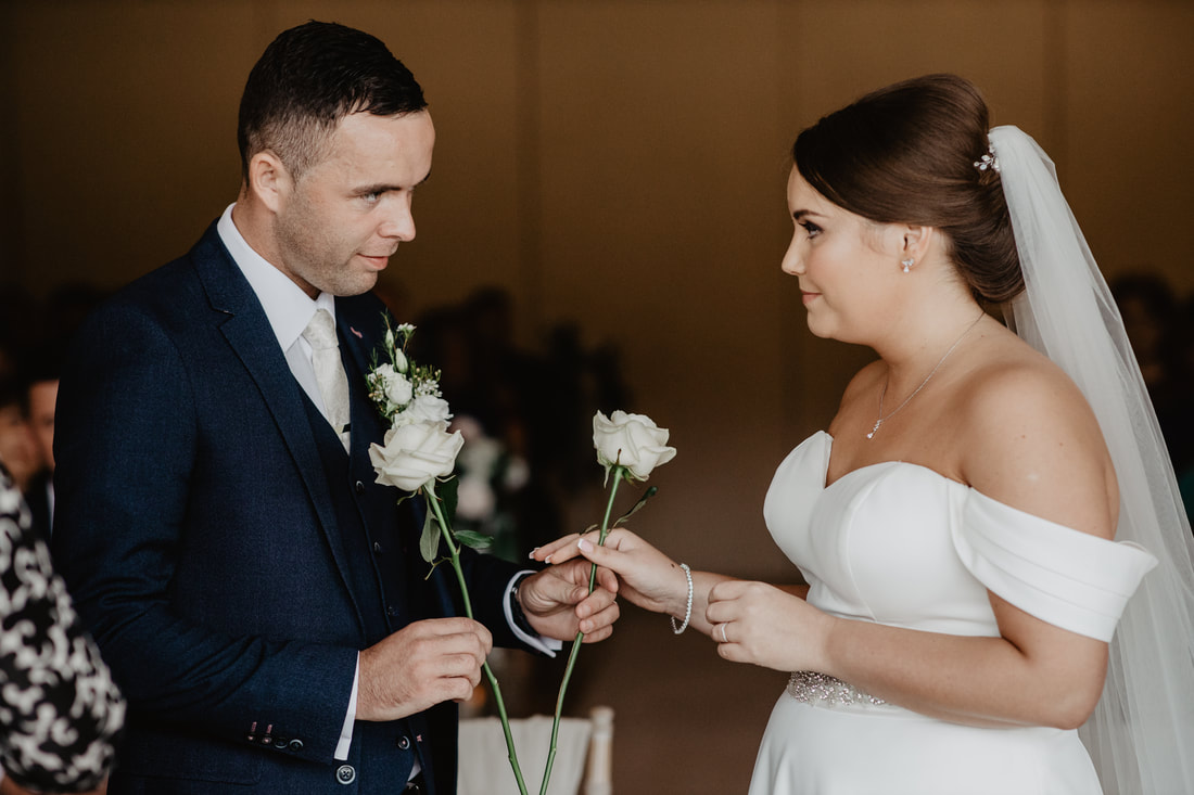 Wedding ceremony tradition with 2 white roses at Clanard Court Hotel, Athy, Co. Kildare by wedding photographer Mario Vaitkus