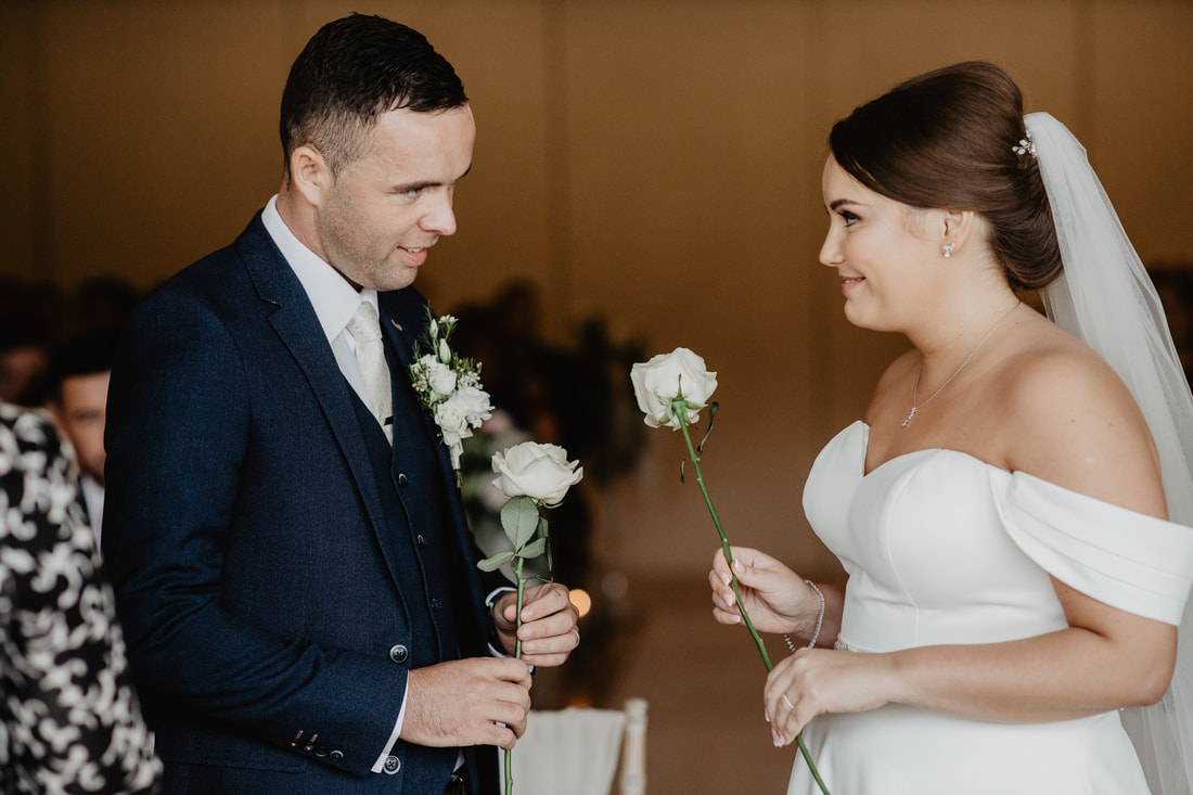 White roses at Clanard Court Hotel, Athy, Co. Kildare by wedding photographer Mario Vaitkus