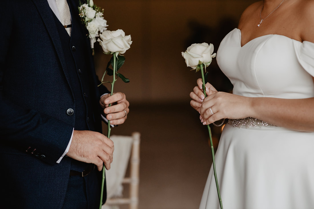 Wedding ceremony tradition, give to each other, white roses, at Clanard Court Hotel, Athy, Co. Kildare by wedding photographer Mario Vaitkus