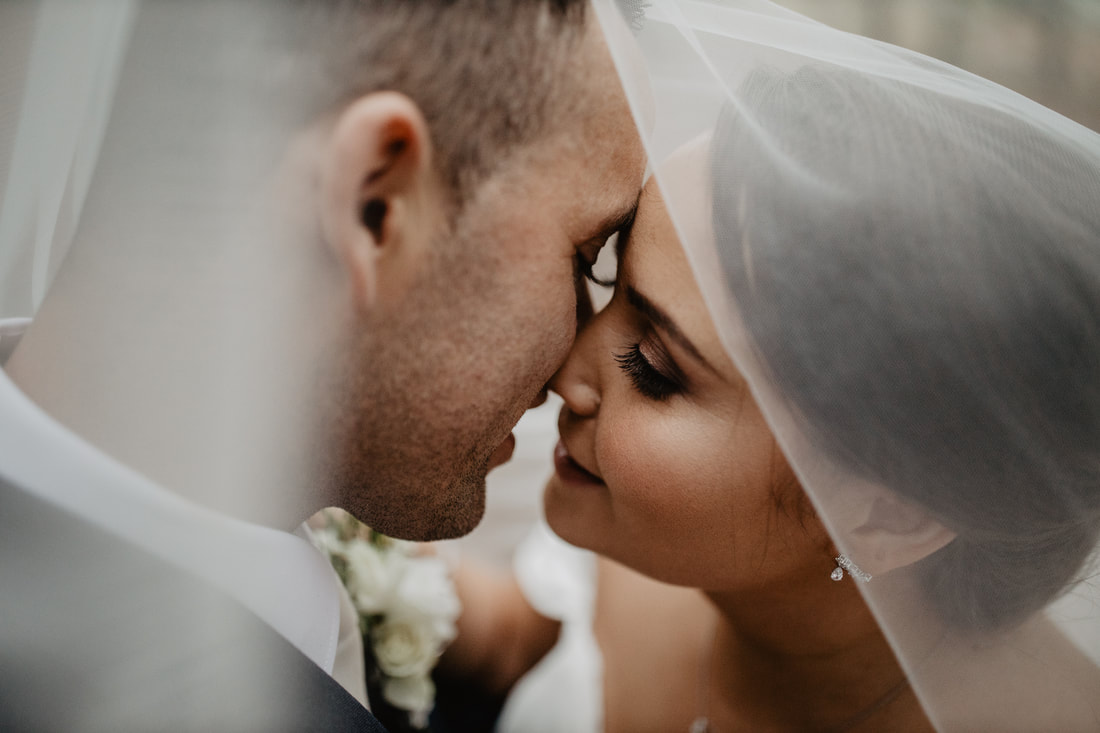 Bride and groom kissing. Wedding photographer in Kildare Mario Photo - Video Production