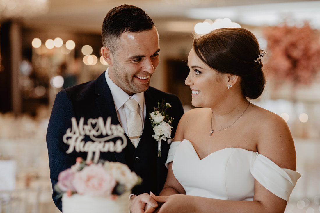 Bride and groom at a wedding cake. Wedding photographer in County Kildare Mario Vaitkus