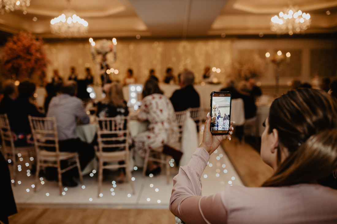 Mobile phone photography at a wedding. Wedding photographer in County Kildare Mario Vaitkus
